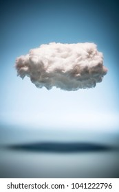 One cloud on a blue background. Weather and digital cloud concept. Cotton handmade.