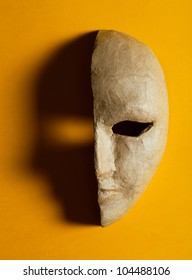 Half of the paper masks on a yellow background