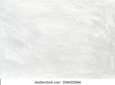 灰色と黒の色合いのブラシストロークで白く洗浄されたペイントされたテクスチャの抽象的な背景。