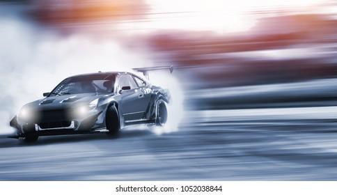 Auto treiben, verschwommen von Bilddiffusion Renn-Drift-Auto mit viel Rauch von brennenden Reifen auf der Rennstrecke