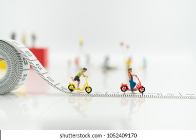 Miniature people: Group of children playing on white background with copy space using as education, boy and girl, children's day concept.