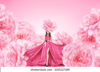 Fashion portrait of young woman in long red dress with big flowers