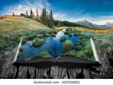 Valle de la montaña alpina a la luz del amanecer en las páginas de un libro mágico abierto. Majestuoso paisaje. Concepto de naturaleza.