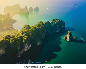 4k aerial view of tropical island, white beach, turquoise lagoon, rocks and islands near Railay and Ao Nang Beach, Krabi, Thailand with added flare