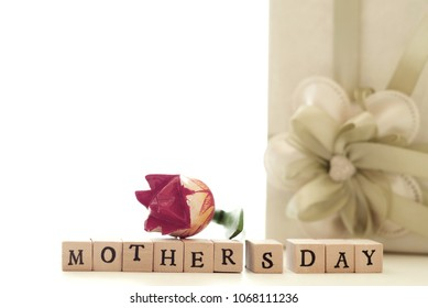 Happy Mother's Day! Vintage effect toned image with wooden stamps.