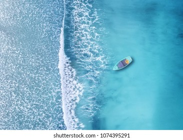 Wave and boat on the beach as a background. Beautiful natural background at the summer time from air
