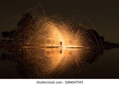 Fire ball long exposure and reflection with Steel Wool in the river.
