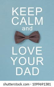Keep calm and love your dad. Card with text and grey bow tie. Concept for father's day greeting.