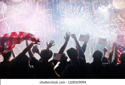Patriotic holiday. Silhouettes of people holding the Flag of the USA. America celebrate 4th of July.