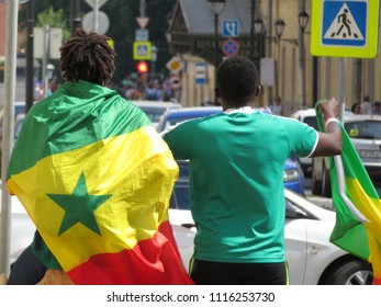 Moscow, Russia - 19 June 2018: Football fans from Senegal in Moscow during the FIFA world Cup 2018. Senegalese fans celebrate the victory of the national team over Poland