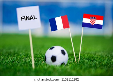 """FRANCE and CROATIA national Flag on football green grass. White table with tittle """"FINAL"""" France - Croatia, FINAL OF FIFA World Cup, Russia 2018"""