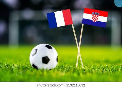 FRANCE and CROATIA national Flag on football green grass. France - Croatia, FINAL OF World Cup, Russia 2018