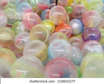 Selective focus colorful transparent gachapon toy capsules