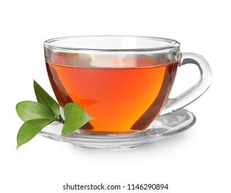 Glass cup of hot aromatic tea on white background