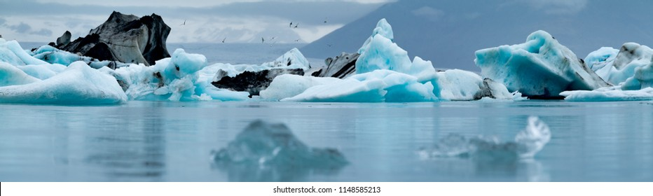 Icebergs floating near the Vatnajökull Glacier in Southern Iceland. These icebergs broke/calved off the glacier and are on their way out into the arctic sea.