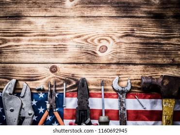 Happy Labor day. Construction tools. Copy space for text on wood background.