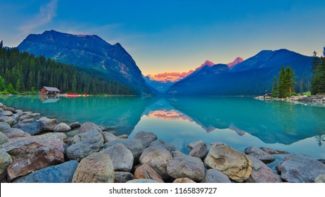 Good mornig Lake Louise.  {Panoramic view of the world famous Lake Louise from shore line to Victoria Glacier.  From the boat rental house to the shore the Chateau Lake Louise.