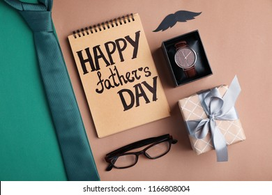 Flat lay composition with male accessories and gift box on color background. Happy Father's Day