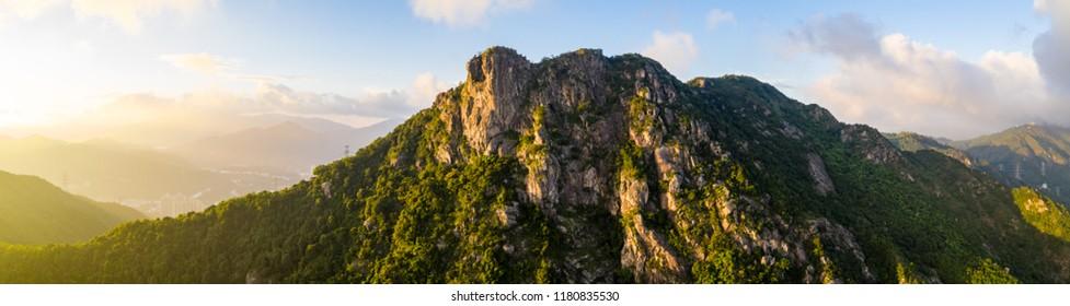 Panoramic of Lion Rock mountain under sunset