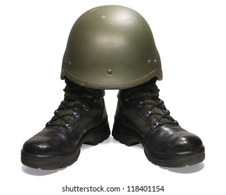 Soldier: military boots and helmet. Isolated on white background. Clipping path (without shadow).
