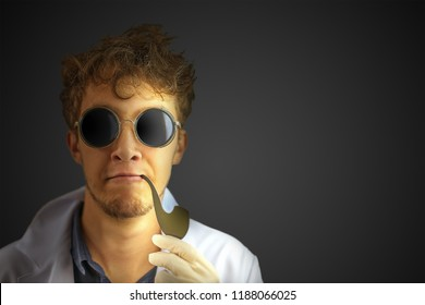 Amazing crazy professor with a smoking pipe in a white robe and dark sunglasses on a black wall background. Halloween costume with copy space for text.
