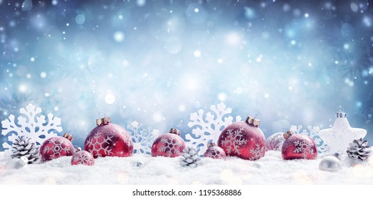 Christmas - Red Baubles Decorated And Snowflakes In Snowing Background