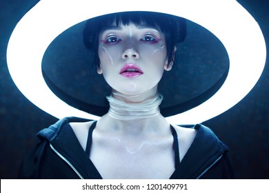 Cyber girl. Beautiful young woman, futuristic style. Portrait against a glowing circle