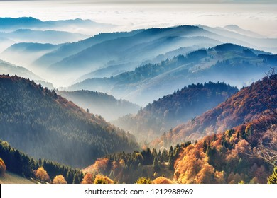 Scenic mountain landscape. View on the Black Forest, Germany, covered in fog. Colorful travel background.