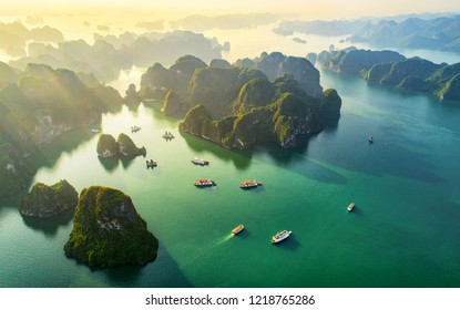 Aerial view floating fishing village and rock island, Halong Bay, Vietnam, Southeast Asia. UNESCO World Heritage Site. Junk boat cruise to Ha Long Bay. Popular landmark, famous destination of Vietnam