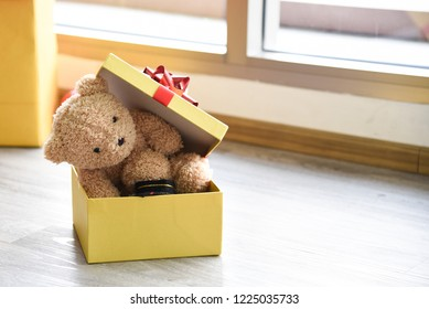 Pretty doll bear inside box for surprise presents on Christmas Day.  Concept Christmas Day, Family Day, Christmas Eve , Happy New Year