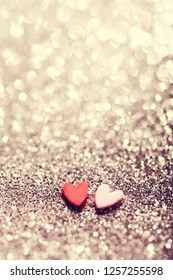 Two hearts on glittery sparkly background. Romantic,Valentine's Day backdrop. Celebrating love.
