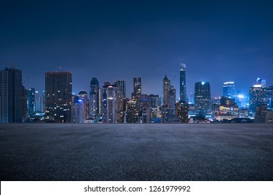Bangkok urban cityscape skyline night scene with empty asphalt floor on front