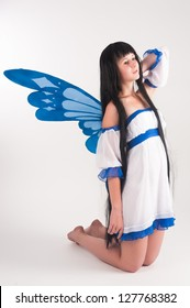 Beautiful anime girl with long hair and wings.