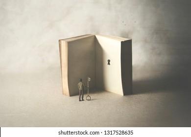 Schlüssel in einem Buch, surreales Konzept