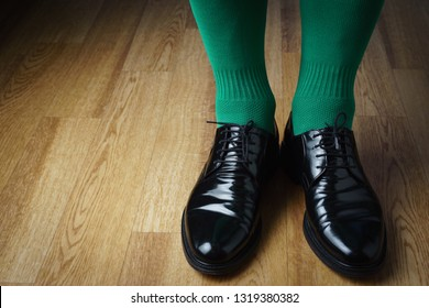 A man in green socks and shoes, St. Patrick's Day
