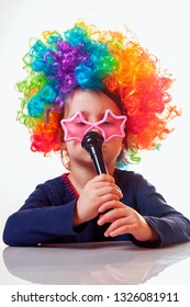 The famous actress. Humorous photo of cute child girl singing with a microphone. Happy childhood, teaching singing, music, child development concept
