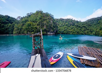 SUP boarding. Sugba lagoon, tourists attraction. Beautiful landscape with blue sea lagoon, National Park, Siargao Island, Philippines.