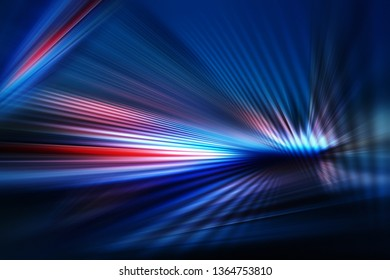 abstract dark background of light with stripes of colourful rays moving from the center