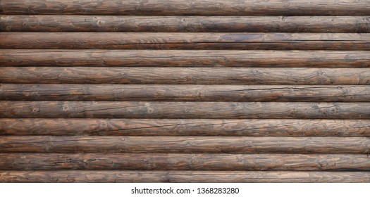 Wooden wall assembled of beams or logs