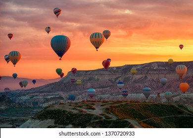 Hot Air balloons flying tour over Mountains landscape spring sunrice Cappadocia, Goreme National Park, Turkey nature background.