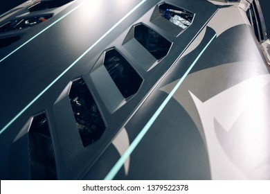 Supercar engine hood with air intake and ventilation