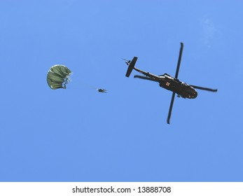 National Guard soldier jumping out from a Blackhawk helicopter