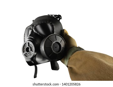 Isolated first person view military hand in tactical gloves holding gas mask on white background.