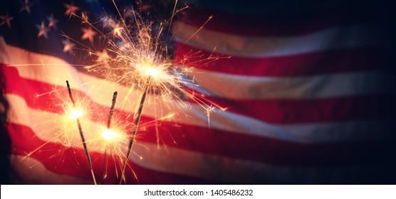 Vintage Celebration With Sparklers And Defocused American Flag - Independence Day