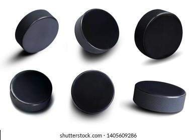 Juego de hockey sobre hielo Disco de hockey de caucho negro en posición vertical con espacio de copia aislado sobre fondo blanco para el diseño deportivo. Esto tiene trazado de recorte.