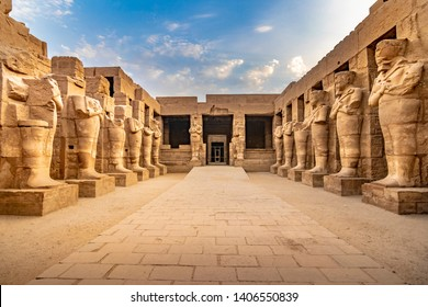 EXPLORING EGYPT - KARNAK TEMPLE - Large sculptures of pharaohs inside beautiful Egyptian landmark with hieroglyphics, and ancient symbols. Famous landmark in the world near Nile River and Luxor, Egypt