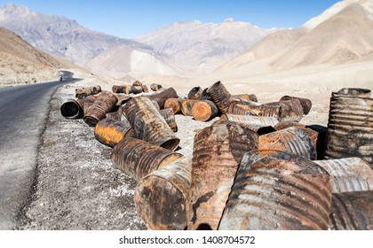 garbage dump of iron barrels on the background of the beautiful mountains of Nepal. Ecological problem. Nepal. Mustang.