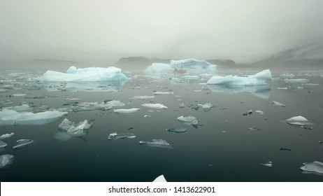 Greenland. Arctic icebergs in the water.