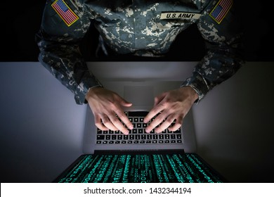 American soldier in military uniform preventing cyber attack in military intelligence center. An US officer intercepting messages to stop terrorism. Modern warfare system surveillance concept.