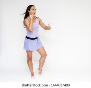 Full-length portrait on white background of beautiful pretty fitness girl woman in trendy tennis sport uniform, with different emotions in different poses, shows hands. Smiles. Stylish trendy youth.